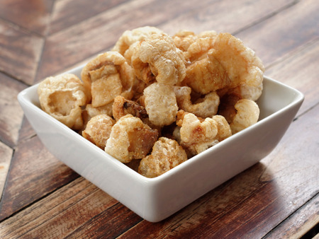 Close Up of Crispy Pork Rinds in a White Bowl