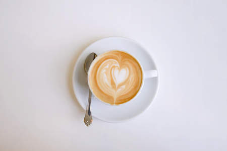 Cappuccino mug with a heart decorated on top of foam