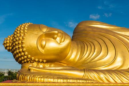reclining: Reclining Buddha statue on blue sky background