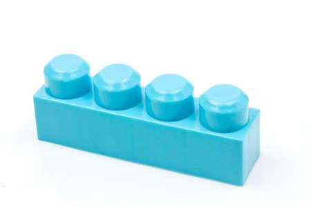 Blue plastic building block isolated on white background. Developmental toys for children. Imagens