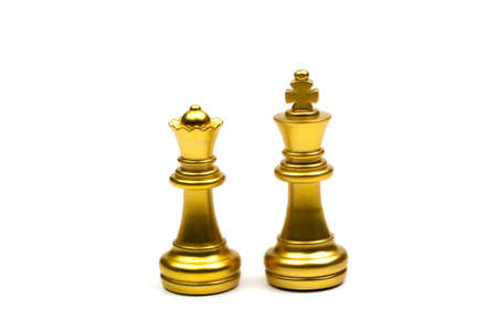 King and queen chess pieces gold isolated on white background. Stock Photo