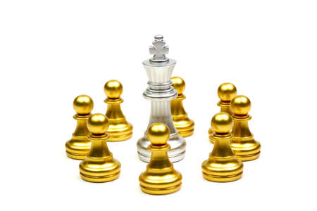 King silver chess pieces fall into the cordon of gold pawn isolated on white background. Stock Photo