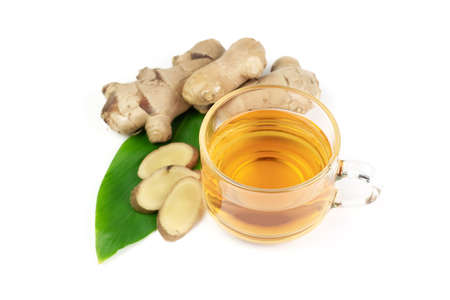 Ginger tea and fresh ginger and sliced isolated on white background. The scientific name is zingiber officinale. Herbs for health care concept. Stock Photo