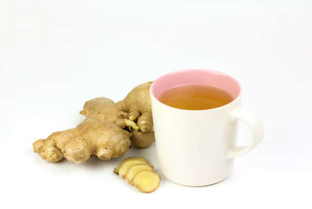 Ginger tea in ceramic cup and fresh ginger and sliced isolated on white background. The scientific name is zingiber officinale. Herbs for health care concept. Stock Photo