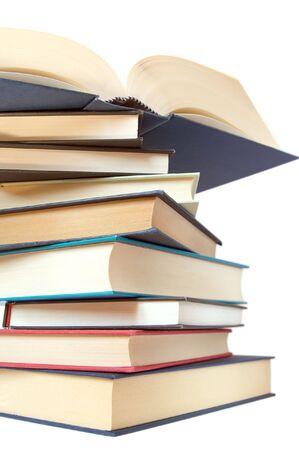 bibliomania: a stack of books isolated over white