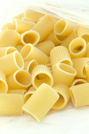 raw italian pasta on white background photo