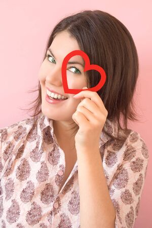 pretty smiling girl with red heart in her hand Stock Photo - 3813718