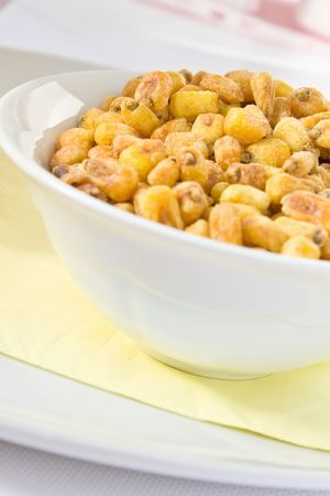 mais: Salted fried mais in a white bowl Stock Photo
