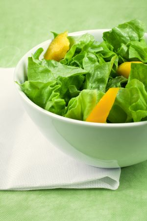A bowl of green salad with peppers  photo