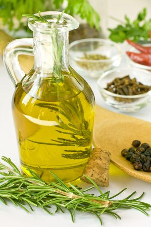 Scented oil with rosmarin and other spices photo