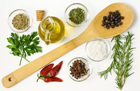 seasoning: Different spices  and on the table on white