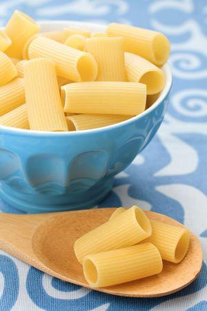 Closeup of italian raw pasta on blue photo