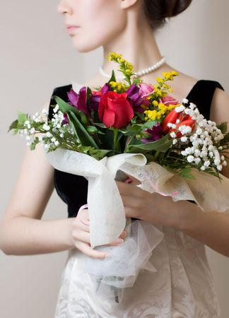 Elegant woman with a bouquet of flowers photo