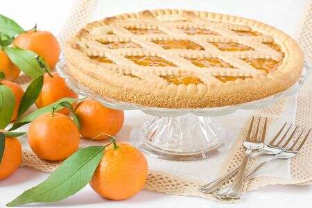 Sweet tart with citrus marmelade on the table photo