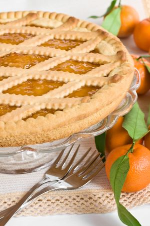 Close up of a tart and some mandarins photo