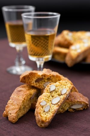 Italian cantucci and two glasses of wine photo