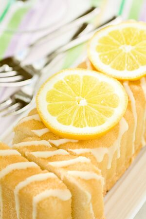 Sliced Cake On A Plate With Lemons photo