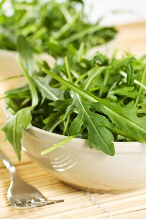 Fresh Green Rucola Salad On The Table photo