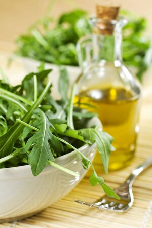 Closeup Of Fresh Rucola Salad And Oil photo