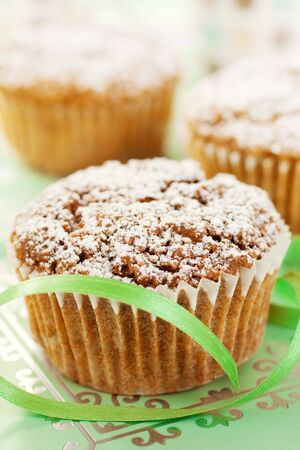 Close Up Of A Muffin and A Green Ribbon photo