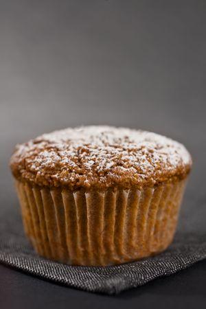 Closeup Of One Muffin On Grey Napkin photo