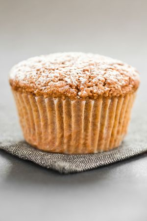 Close Up Of A Muffin On A Grey Napkin photo