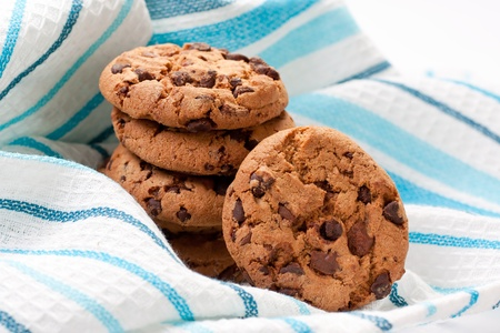 chocolate chip cookies: Closeup of chocolate cookies on a blue napkin