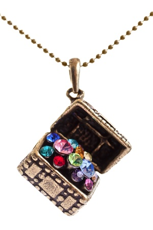Closeup of a Treasure box jewel with colorful stones photo