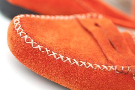 moccasins: Closeup of orange leather shoes on white background