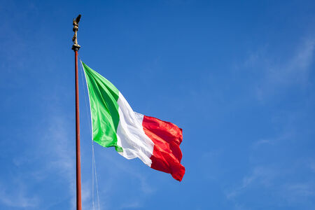 Big Italian Flad over blue sky in Rome Stock Photo