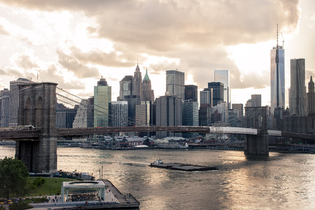 city night: Dowtown view of New York at sunset with warm toning and dramatic sky
