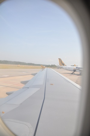 a view of airport from airplane window