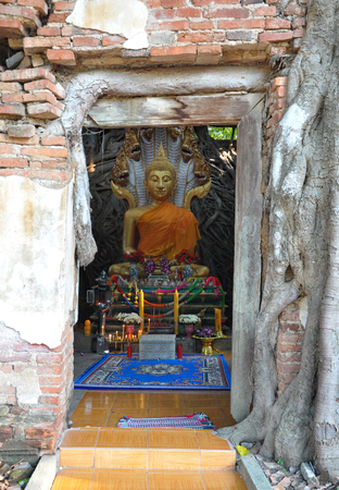 wicket gate: Buddha in ancient temple Stock Photo