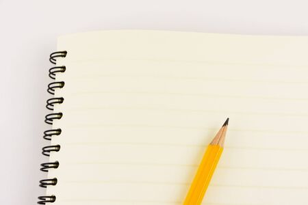 grafit: Pencil and notebook isolated on white background with copy space.