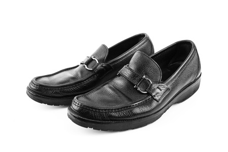 Black leather shoes isolated on white background with copy space.
