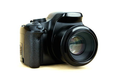 Bangkok, Thailand - June 7, 2017: digital dslr camera in APS-C sensor with fix lens on canon brand isolated on white background. 新闻类图片