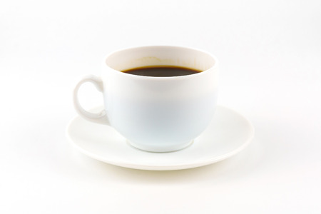 Coffee on white cup and saucer isolated on white background with copy space.