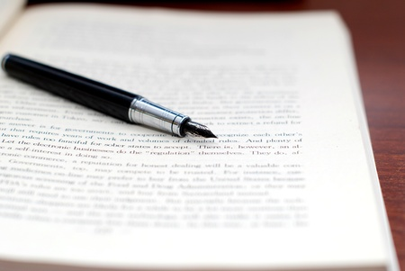 writing western: Pen and book Stock Photo