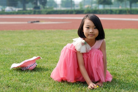 Asian little girl  In summer garden photo