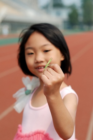 Asian little girl and mantis  photo