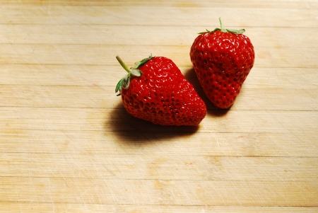 Strawberry on a chopping board photo