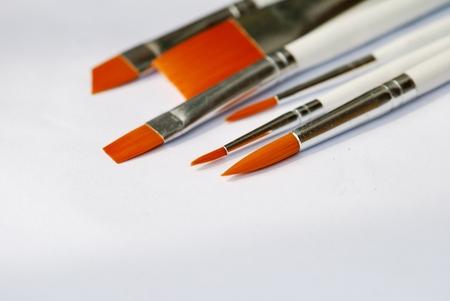 Many brushes isolated on white photo