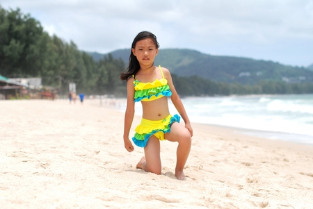 swimsuits: Asian little girl at the beach Stock Photo
