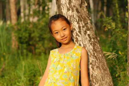 Asian little girl at outdoors. photo