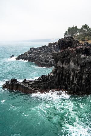 columnar: Basaltic columnar joint coast in JungMun in Jeju Island Stock Photo