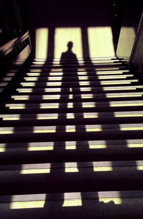 man: Shadow of man on steps