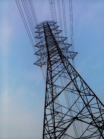 industrial: Energy tower on blue sky background
