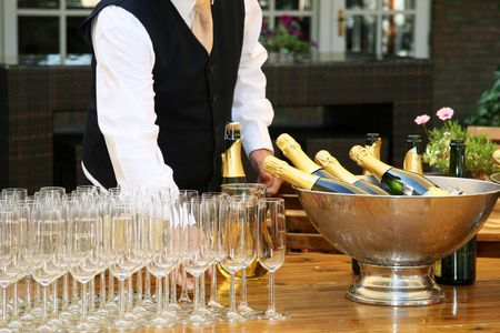receptive: A waiter filled champagne glasses Stock Photo