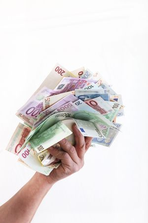 euro currency with a hand in front a white background Stock Photo - 6437453