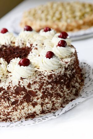cake with icing: Cherry cake with chocolate - cake - close-up Stock Photo